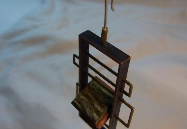 Orecchini realizzati in rame, ottone, argento e stoffa
